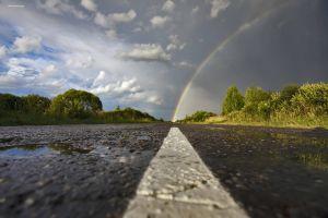 wet road rainbows road