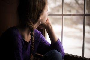 window sweater brunette women looking away