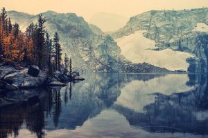 winter nature reflection lake snow rock mountains trees landscape