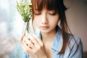 women auburn hair closed eyes asian face flowers