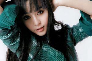 women bingbing fan arms up asian face simple background model