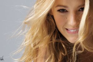 women blake lively blonde actress face curly hair biting lip