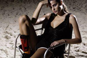 women legs isabeli fontana cleavage model black dress sand