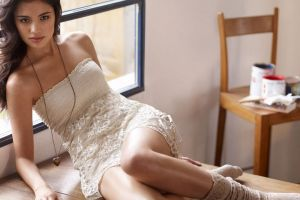 women legs sitting necklace dress