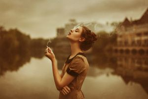 women outdoors closed eyes smoking cigarettes women sepia polka dots arms on chest looking up