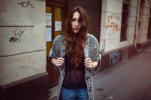 women outdoors janina knopf  sweater jeans urban women long hair