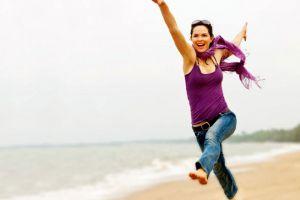 women outdoors jeans women beach jumping