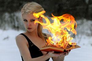 women outdoors winter women fire books fantasy girl burning green eyes blonde