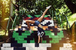 women outdoors women shorts jeans model legs stairs handstand