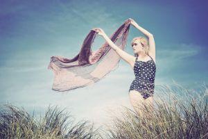 women polka dots windy women outdoors one-piece swimsuit blonde armpits