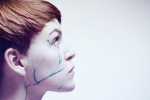 women profile model looking up face