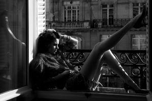 women sitting monochrome jean shorts model balcony high heels hands in hair window torn jeans city window sill stiletto legs old building