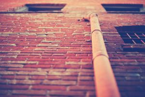 worm's eye view building bricks wall architecture warm colors window
