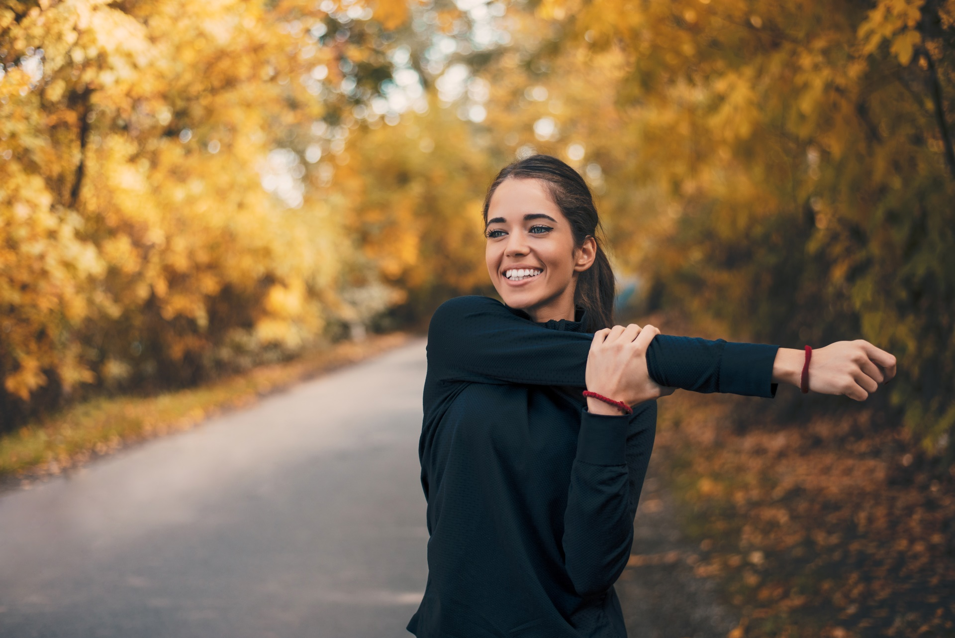 fitness model women smiling road women outdoors working out trees fall