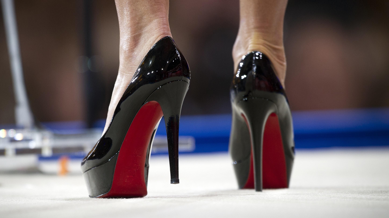 louboutin black heels depth of field women legs stiletto high heels