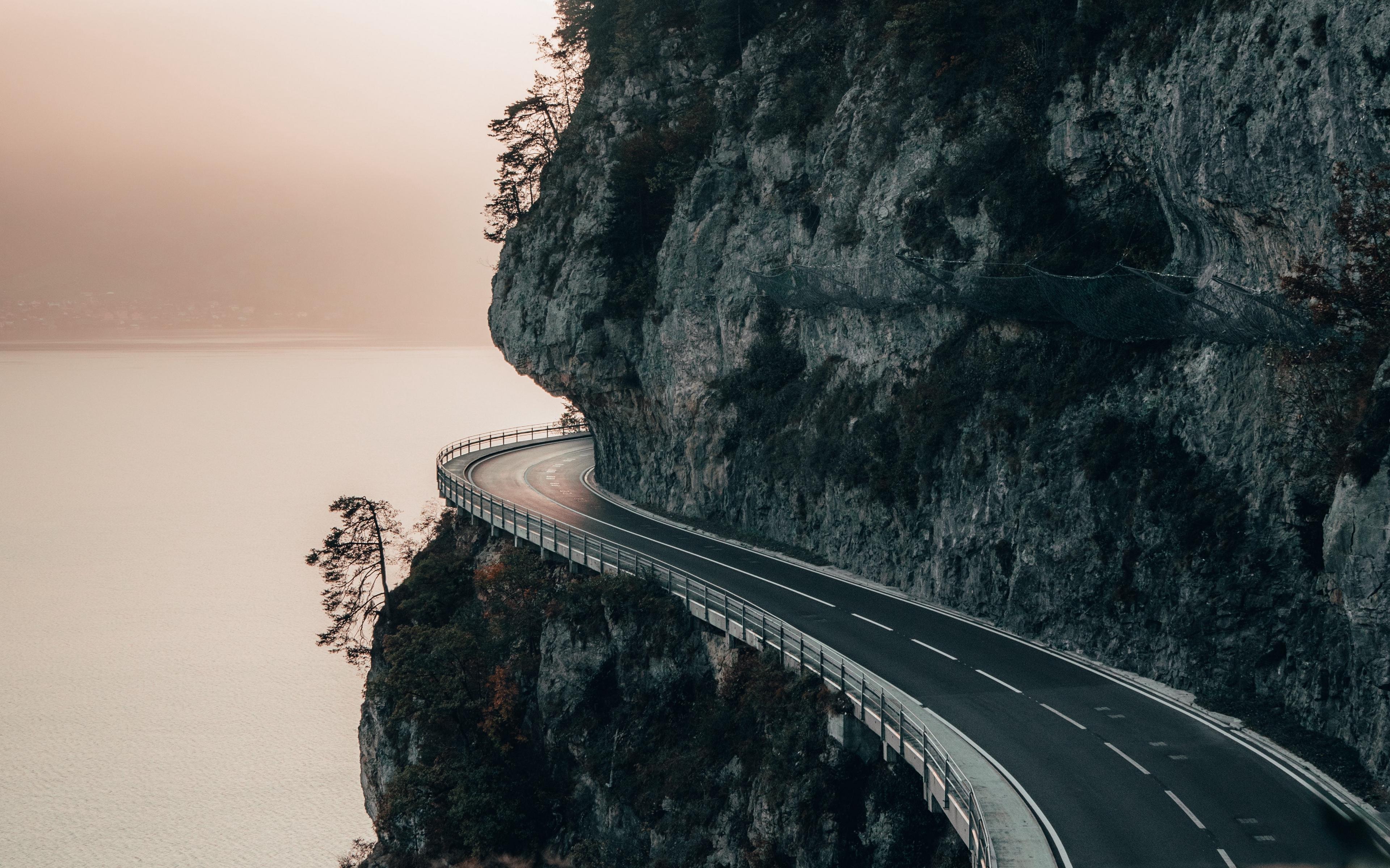 nature cliff mountains road sea landscape switzerland