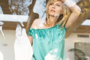 actress looking out window arms up celebrity women kirsten dunst