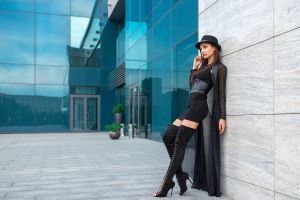 albert lesnoy building portrait tight dress looking into the distance women with hats minidress outdoors knee-high boots black dress hat women brunette model women outdoors