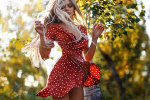 anton montbrillant dancing red dress women outdoors polka dots long hair women necklace blonde