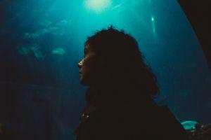 aquarium side view water face women