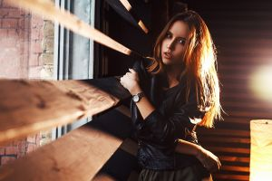 arms crossed vlad popov indoors looking at viewer depth of field women indoors model brunette leather jackets watch women