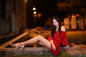 asian sitting dress legs bare shoulders brunette night high heels smiling looking away women outdoors red nails fountain women water