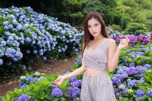 asian women brunette model long hair flowers women outdoors looking at viewer grey dress