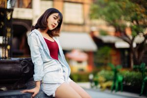 asian women outdoors depth of field model women jeans shirt jean shorts brunette looking into the distance