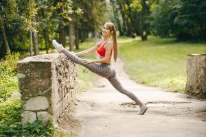 ass ponytail model women stretching yoga pants leggings brunette outdoors