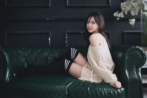 bare shoulders long hair model sitting brunette sweater looking at viewer women indoors women knee-highs white flowers couch asian