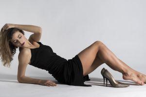 barefoot women feet white background stiletto legs luigi malanetto brunette tiptoe black dress high heels