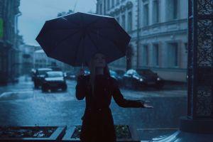 black clothing rain blonde women outdoors black coat public coats umbrella car photography women looking up