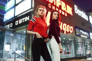 blonde brunette women outdoors fashion two women model women street neon lights looking at viewer