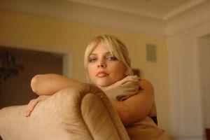 blonde make up looking at viewer in sofa jana jordan women