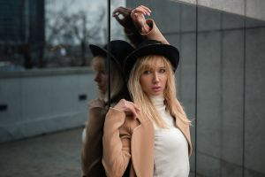 blonde pink lipstick hat portrait women coats white sweater turtlenecks reflection
