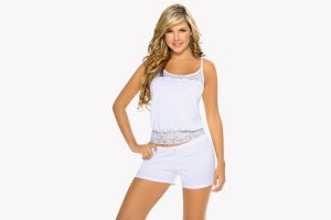 blonde smiling simple background white tops white background shorts women hands on hips liliana henao model