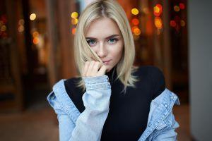 blonde women freckles jeans jacket depth of field blue eyes portrait touching hair turtlenecks looking at viewer model