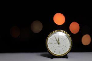 bokeh clocks blurred black background