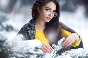 branch portrait yellow sweater sergey sorokin snowing pine trees outdoors brunette women outdoors glasses depth of field bokeh coats women with glasses long hair
