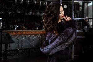 brunette model indoors glamour women glamour women black dress bar dress red lipstick women indoors touching face fur coats depth of field