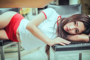 brunette t-shirt women indoors asian lying on side belly model women chair booty shorts looking at viewer