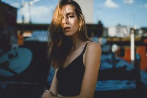 caitlin nusche tank top brunette black tops model women women outdoors hair in face necklace rooftops long hair looking at viewer samalive