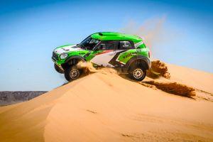 car racing rally sand dunes vehicle