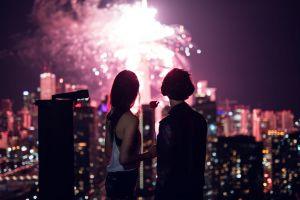 cityscape fireworks night city lights people women couple