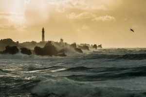 coast waves sunlight rocks clouds sea landscape lighthouse mist
