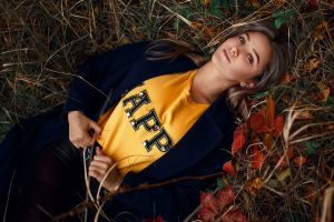 coats lying on back portrait women leaves women outdoors outdoors looking at viewer sergey sorokin yellow tops crop top top view fall forest model