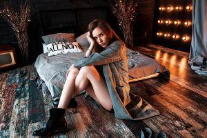 coats pillow sitting legs crossed women looking at viewer brunette indoors portrait women indoors vlad popov bed boots on the floor model