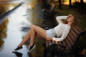 converse model legs white tops portrait curly hair grass touching face dbond sitting bench women jean shorts outdoors women outdoors