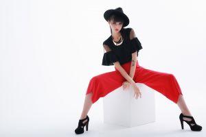 dark hair white background women model simple background spread legs sitting hat