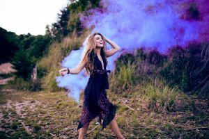 depth of field smoke smiling women women outdoors hands on head blonde dress model